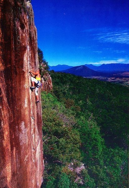 Paul Smith on the FFA of Whistling Kite (aka Crack of Dawn) (32/5.14a), Frog Buttress<br> <br> Photo by Clare Blues