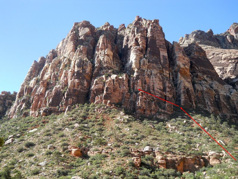 Approach: Hike up the canyon past the route.  Head up the hill to the right of low red wall.  Turn left and follow the trail above the white headwall to the start of the route.