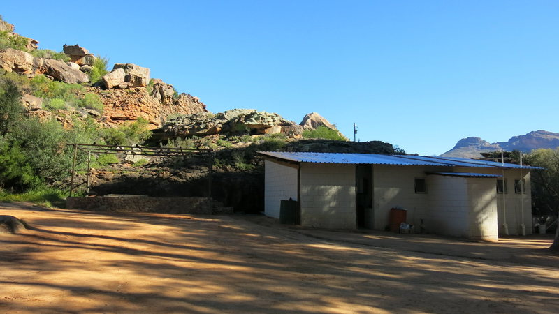Kitchen is on the left, showers and toilets are on the right.