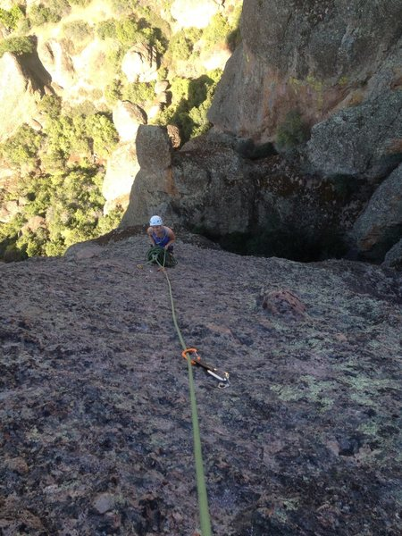 """The hanging belay atop P2 and a view of the """"runouts""""."""