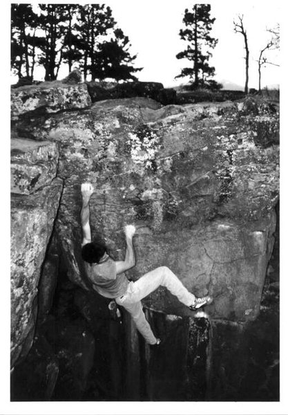 Mike Gasch on a variation on the Block Roof boulder, 1999.