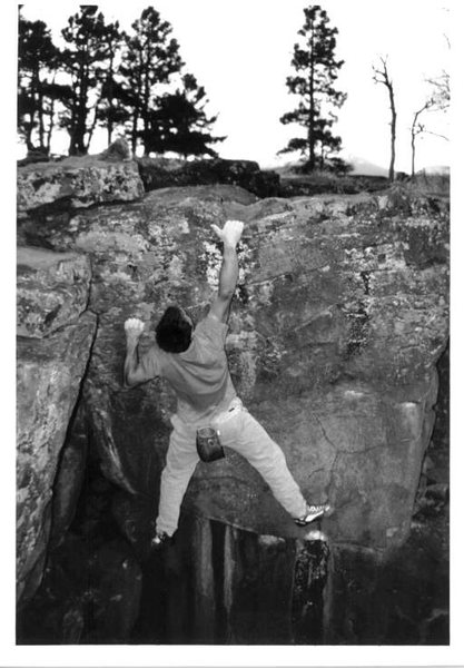 Mike Gasch punching to the top, on the Block Roof boulder, 1999.