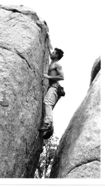 Mike Gasch warming up at The Daugherty St. boulders, 1999.