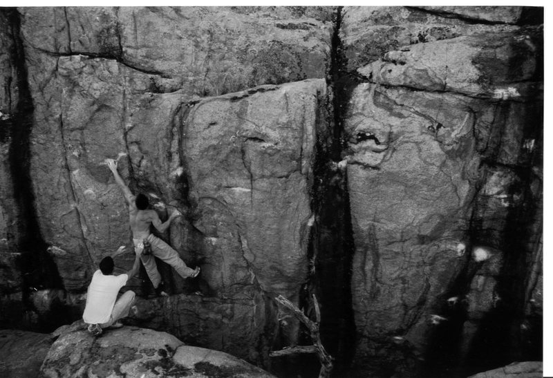 Mike Gasch dealing well with a Painful Truth V4, Thor's Chasm, Watson Lake, 1999.<br> <br> Voodoo Blues is the chalked up black streak on the far right.