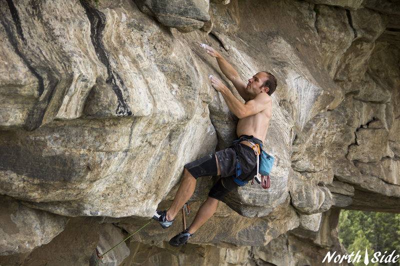 The crux pull onto the pegmatite mini-slab.<br> <br> Photo Keith North.