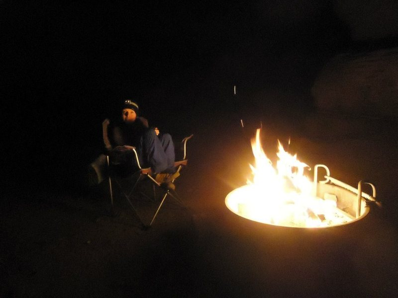 smiling whilst shivering, when the weather starts to take a turn for the worst, at least we have fire! indian creek camping mid april 2014