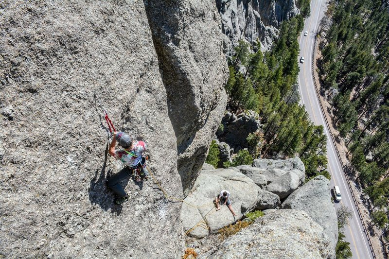 Mark Rafferty and John Lang working on a ground up first ascent on the front face of Dire Spire.