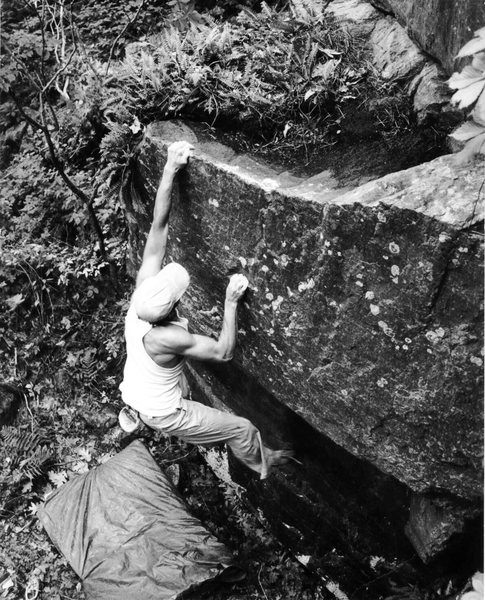 Bouldering out an FA on The West Bluffs, Devils Lake, WI 1997/98<br> <br> Eric Zschiesche photo