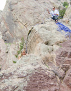Rock Climbing Photo: Bride Topping out the Bomb with Groom belaying - E...