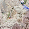 Bride Topping out the Bomb with Groom belaying - Eldorado Canyon State Park