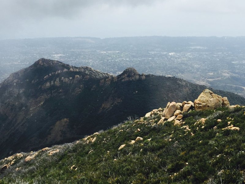 Looking down at the back side of Cathedral Peak from La Cumbre.