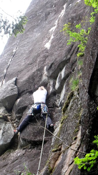 On the second pitch of Velvet Pedestal, just past the slab start, about to enter the layback crack.