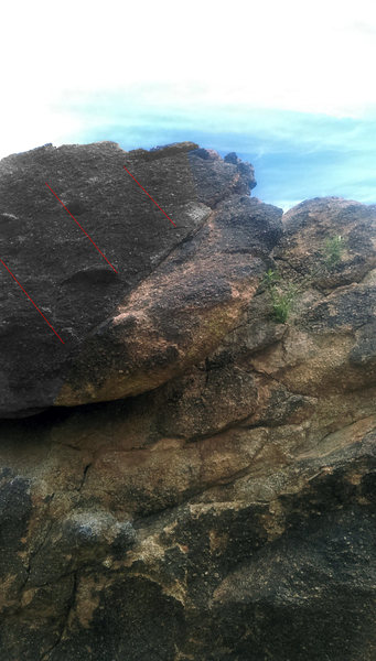 Right edge of top boulder. This edge starts at the crack.