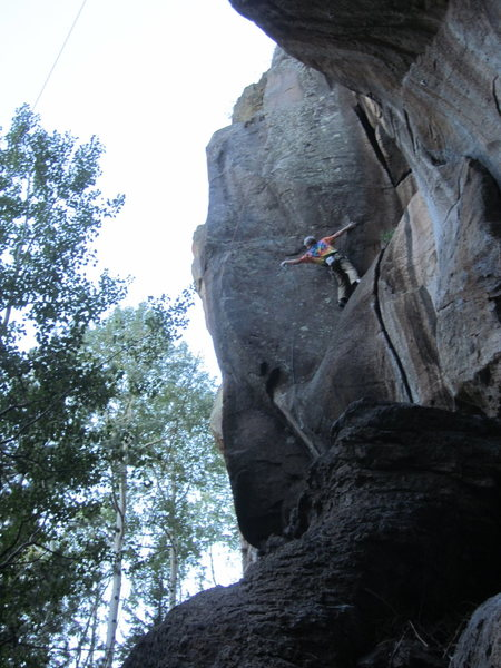 BK preparing for the desperate slab crux before moving left to the arete.