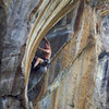 Powerhouse Keith Beckley warming up the guns on Be The Burn 5.11+, The South End, Peaks Crag.