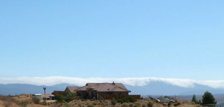 Clouds spilling over the top of San Bernardino Mountains near Hesperia, High Desert