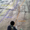 You can't tell, but there is a smile under there.<br> <br> Missing the start of the route.<br> <br> (Don't touch the crack to the right of the black line for a harder crux!)