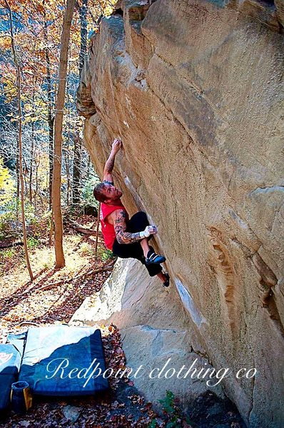 Eric Gifford attempts to lock off the crux move on Eco