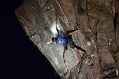 Rock Climbing Photo: Moving through the jugs on the roof in the dark.