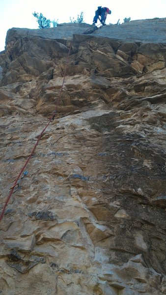 Nate Burns coming off belay at the top of Knuckle Sandwich