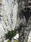 climbers at base of potato chip flake. Photo taken by hiker on other side of chasm