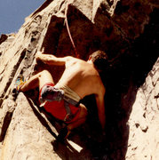 Back in the day, ~1989, 90 Foot Wall, Lightning Bolt 5.10b -- getting ready to go over.....