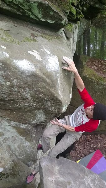 Oliver Richman sticking the slopey lip to begin the left traverse to top out the lip.