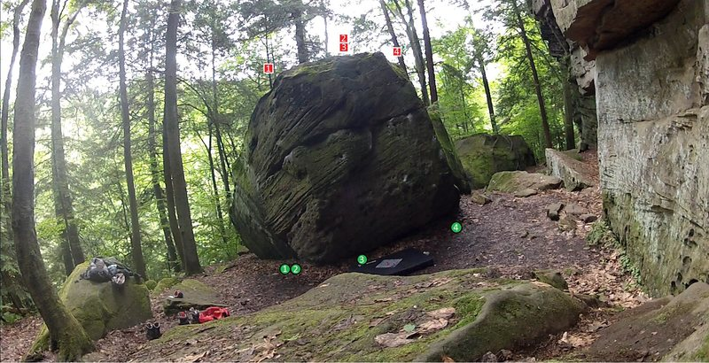 Photo of boulder on north end @ McConnels Mill State Park.<br> <br> 1. straight up <br> 2. Fun. start at 1, traverse crack over to nice edge on 3, and continue up.<br> 3. straight up, sit start to make harder<br> 4. difficult sit start
