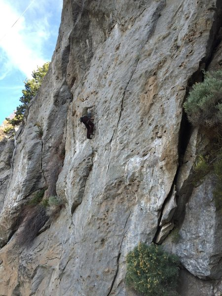 Roadside Distraction is to the climbers left and takes the off width dihedral.