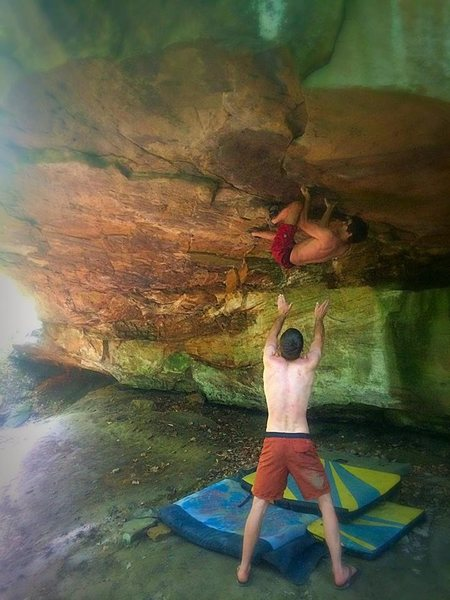 Nate Yokum, owner and local operator of Rock Candy holds takes a lunch break from the shaping room for a high noon bouldering session on this Classic Brecksville line