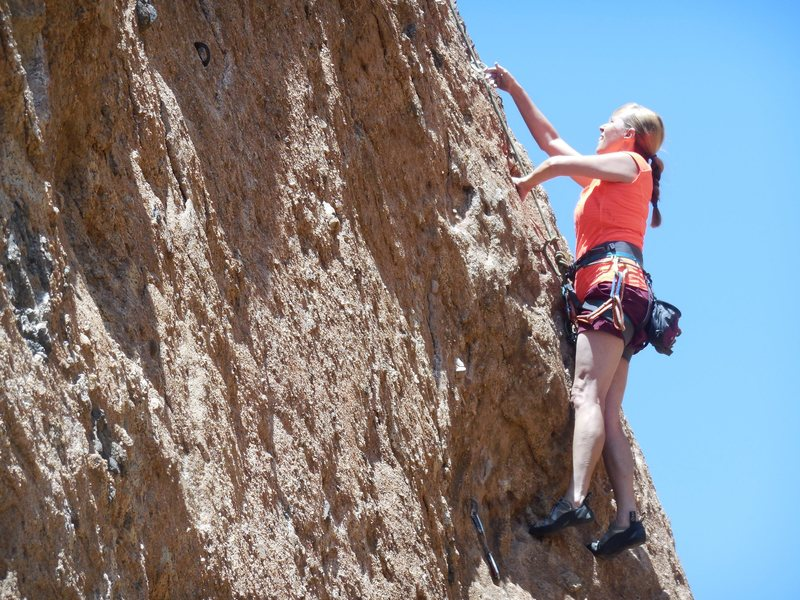"""Enjoying the beautiful pockets on """"BTS"""" after pulling the crux."""