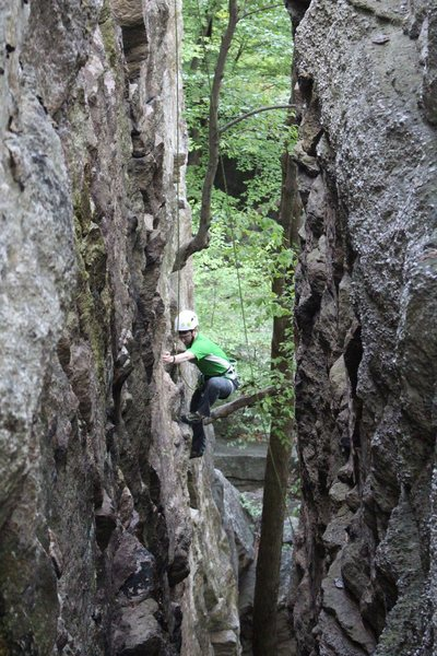 Side view through the crack of a climber on the route