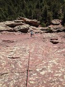 Rock Climbing Photo: Moving left over the red rock.