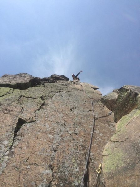 Hannah just above the section where you grasp the ridge itself. Probably the best moves of the climb