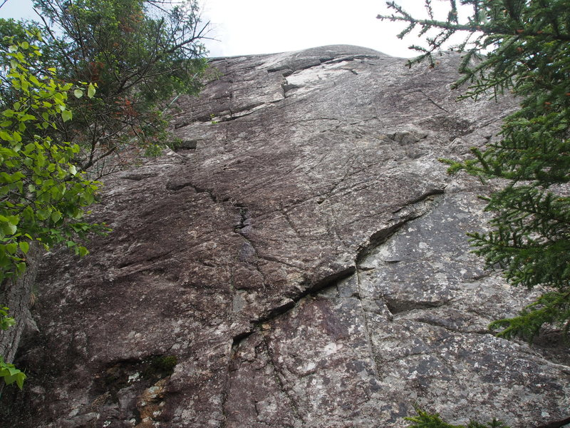The middle and right of the 3 routes on the topo-sketch of the North / West Face. Taken from the tree ledge.