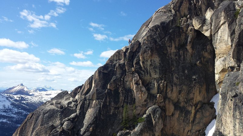 Unknown climber on SW Rib as seen from the S Arete.