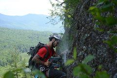 Rock Climbing Photo: Bolting on Rancid Meat (5.10c)