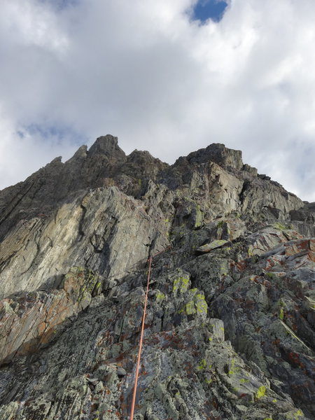 Typical climbing along the crest. At the top left you can see the red gully that marks the end of the route.