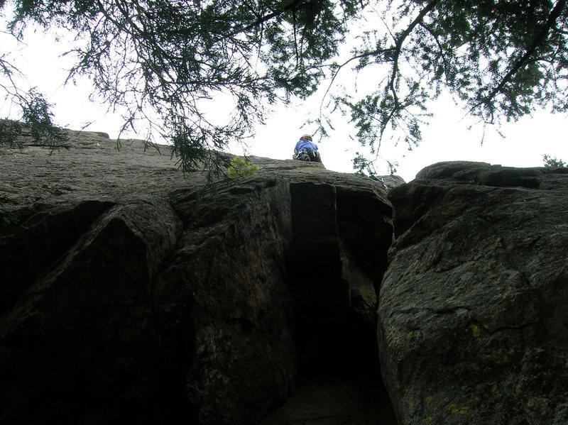 Deb climbs above the crux.