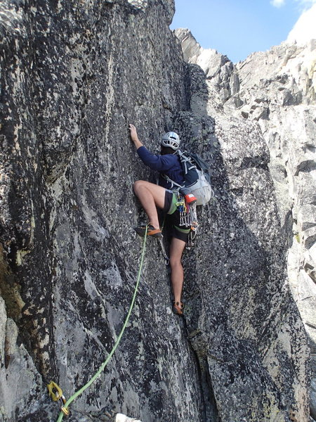 Climber in the off-width at the start of the 4th pitch.