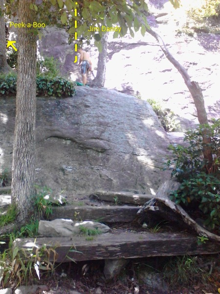 Near base of Peek-a-Boo. It's to the left of him up a short scramble about 20 feet. He is standing right at the base of Jim Dandy. <br> These 3 wooden steps are the only wooden steps on the trail for Table Rock, so they are a good landmark for finding other routes.