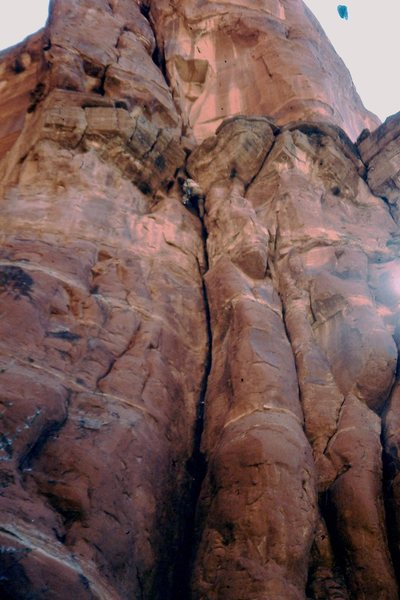 Kim Spence approaching the Ft Apache Limestone band, always a fun sequence in Sedona.  FA Firecat Direct start ~1980