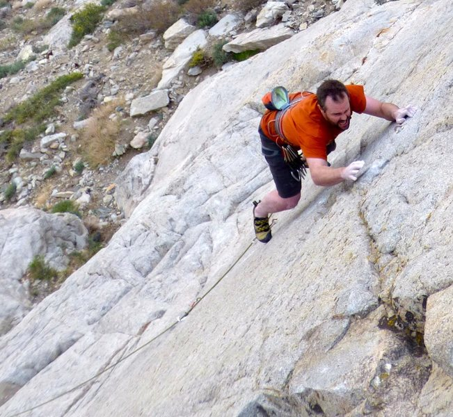 Trying hard to not whip off the crux on the first ascent.
