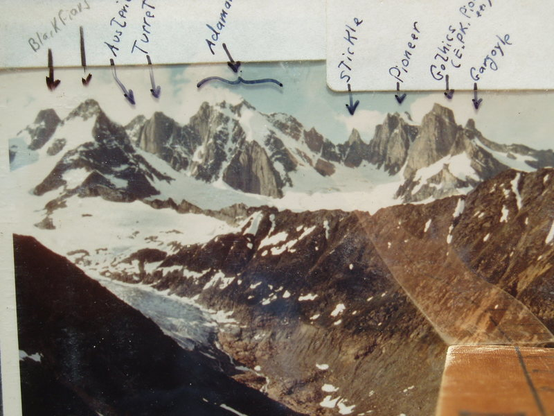 """The South Faces of the Adamant-Austerity Range. Adamant glacier below the peaks; Friendship Col out of sight to the right. Thor Pass to the right of Gargoyle. The ridge in mid-photo is """"Azimuth Ridge"""". Cairn cabin is in the foreground valley, out of the photo. [ I believe it's the Silvertip and/or Haywood glacier on the left.] photo taken circa 1967"""
