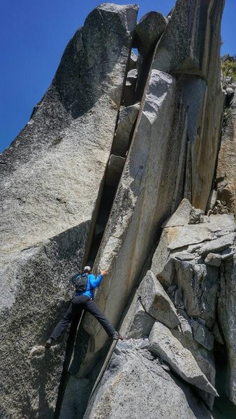"R Shore entering the ""4th  class"" crux on the SW Arete of Grizzly Peak. Photo J McKee"