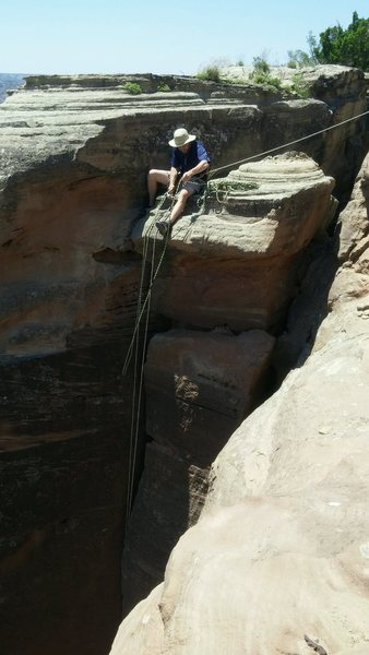 """Setting anchors for top rope on top of """"Warpath"""". Tied off to boulder found about 20 feet away then put a figure 8 on a bite with biners to run top rope through."""