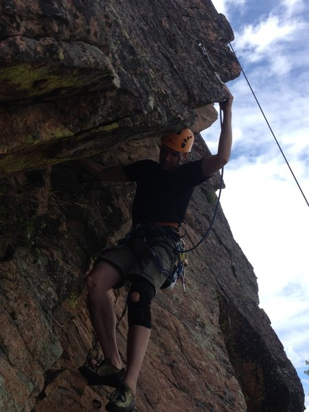 Preston Evans working the crux roof.