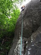 Rock Climbing Photo: Thru the crux on the FA. Photo by Amy Colburn