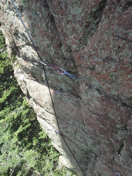 Part the face climbing, the climb sort of follows the arete and trends right at the top towards some painted chain anchors.