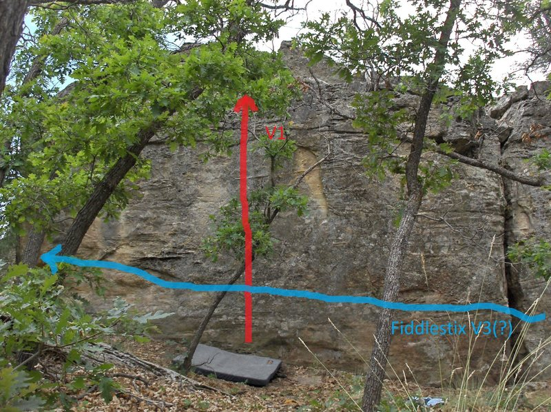 Climb straight up through small edges on the left half of the rock.